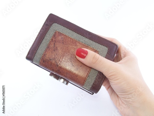 woman's hand holding wallet