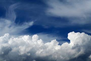 white clouds in the dark blue sky