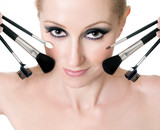 female face with cosmetic makeup brushes poster