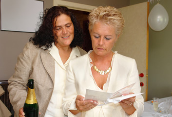 lesbian couple reading marriage congratulations ca