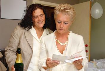 lesbian couple reading marriage congratulations ca