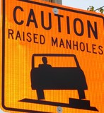 caution,  raised manholes sign poster