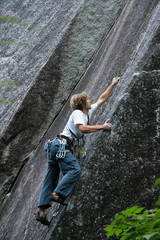 climber placing gear
