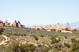 touring in arches national park 3 poster