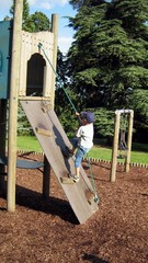 child/boy climbing frame/wooden structure.playing.