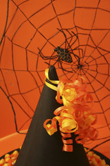 spider web, witch's hat, and ribbons