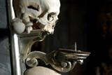 candelabrum form human skulls poster