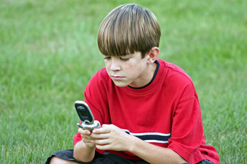 boy playing on cell phone