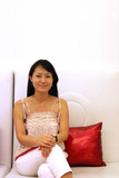 korean woman on a white couch poster