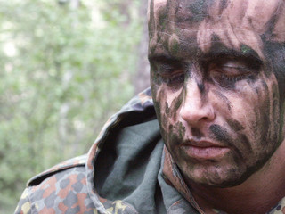 man in field makeup