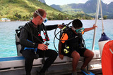 scuba instructor and kid poster