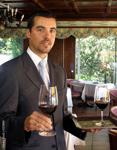 butler is serving wine