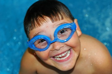 boy with goggles loves swimming