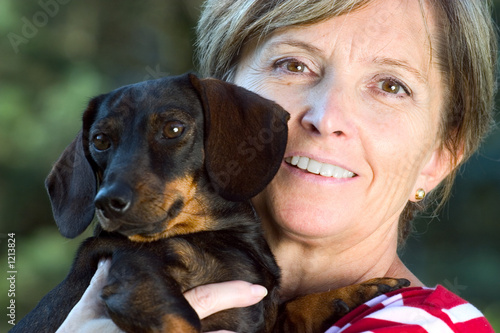 smiling woman and small dog