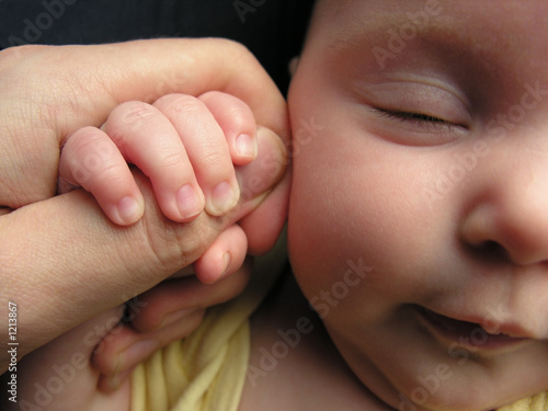 baby sleep with father's finger