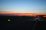 busy airport taxiway at dawn poster