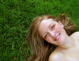 woman laying in grass poster