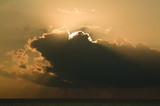 rays of sun coming from behind sunrise clouds poster