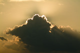 sunrise cloud with sun rays coming from behind poster