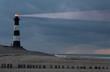 Leinwandbild Motiv lighthouse in the dusk