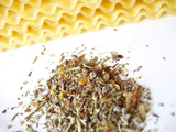 italian spices with uncooked lasagna noodles poster