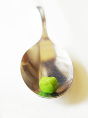pea on the end of spoon