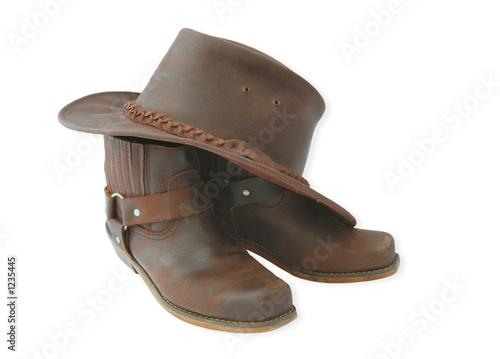 Leinwanddruck Bild boots and hat-brown