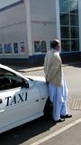 a man waiting wearing muslim/indian custom/fashion poster