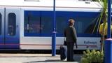 passenger/traveler/tourist waiting in train statio poster