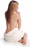 Fototapety alana applying lotion to shoulder