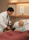 doctor taking senior blood pressure poster