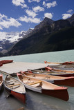 canoes in lake louise poster