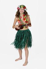 preteen girl dressed as hula girl
