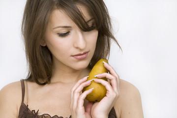 girl posing holding pear