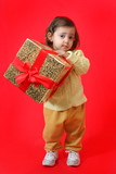 toddler with a christmas gift poster