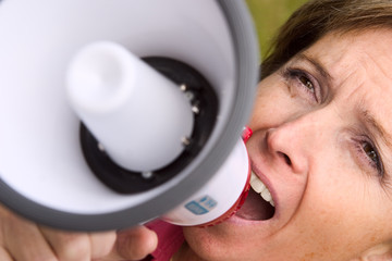 woman shouting at the megaphone