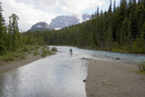 river with glacial water and mountain bikers poster
