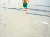 boy running on beach poster