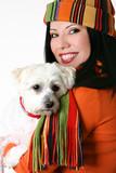 female cuddling a pet dog poster