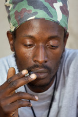 rastafarian man smoking marijuana