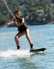 girl wakeboarding on the lake