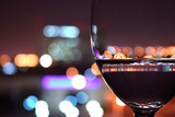 Naklejka wine glass with blurred lights
