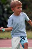 boy hitting the ball poster