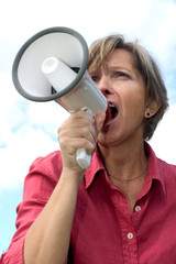 woman shouts through a megaphone