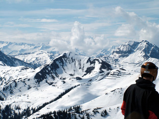 man looking across ski slopes
