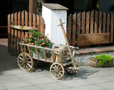 decorative cart, rustic style decoration. flowers, poster