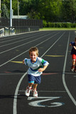boys running on track