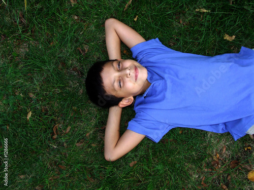 poster of boy laying in grass