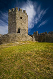 medieval castle with deep blue sky and clouds poster