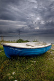 blue boat and stormy clouds poster